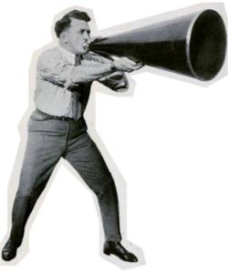 Ince con megáfono